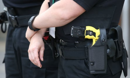 A police officer carrying a Taser