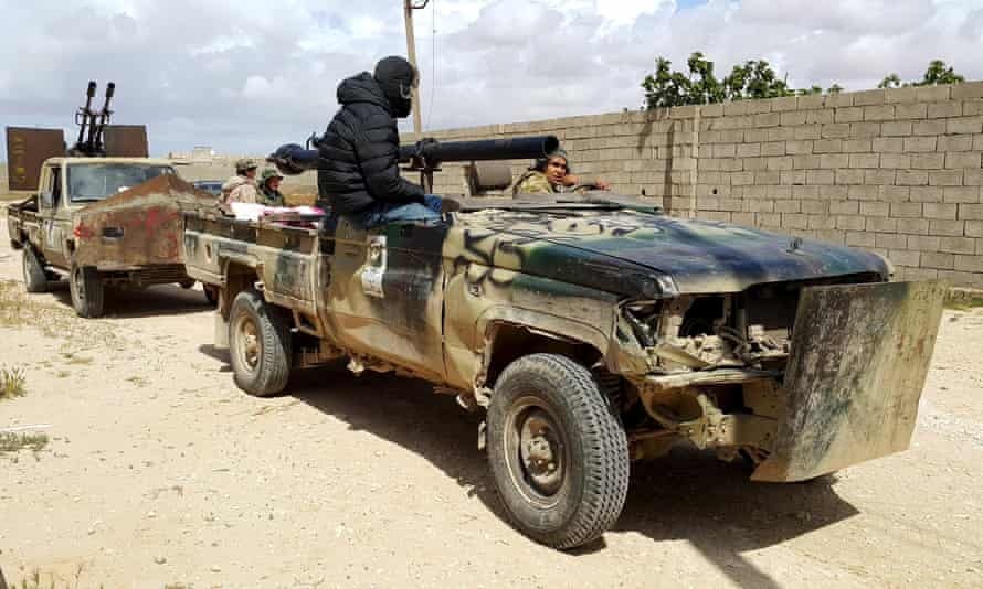 Forces loyal to Libya's eastern government in clashes in Benghazi with Islamist group Ansar al-Sharia.