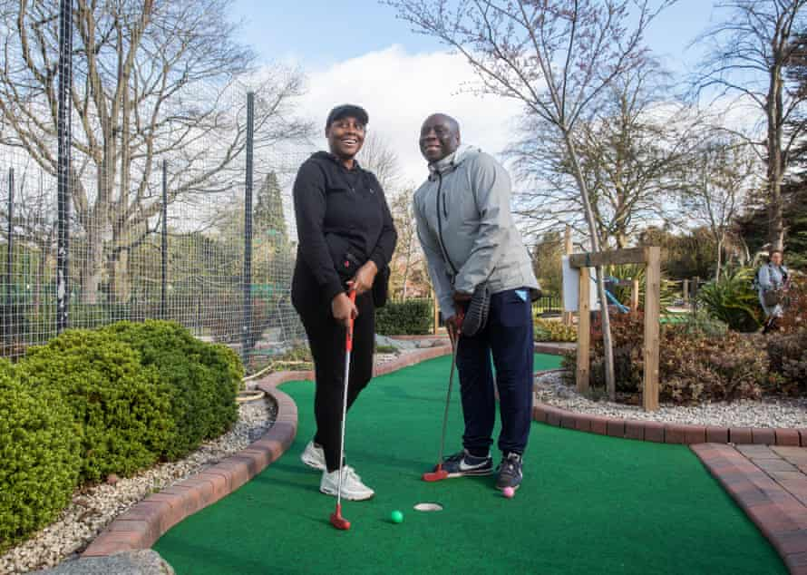 Father and daughter Carl and Shola Easy of Birmingham having a game of crazy golf in Cannon Hill Park.