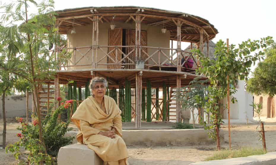 Yasmeen Lari outside the women's centre on stilts she designed in Sindh province.