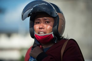 Samidah, a relative of a victim, cries outside the collapsed Roa Roa hotel in Palu