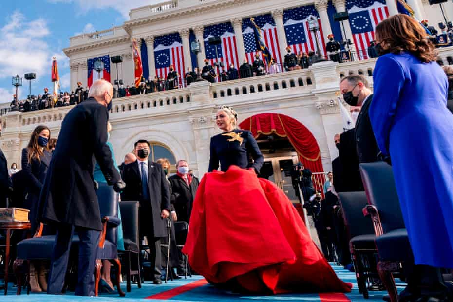Lady Gaga arriving in a red silk ballgown skirt to perform the National Anthem