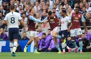John McGinn of Aston Villa clashes with Kyle Walker-Peters of Tottenham Hotspur.