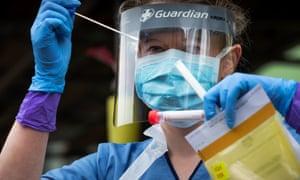 A nurse taking a swab to test for Covid-19 in Edinburgh.