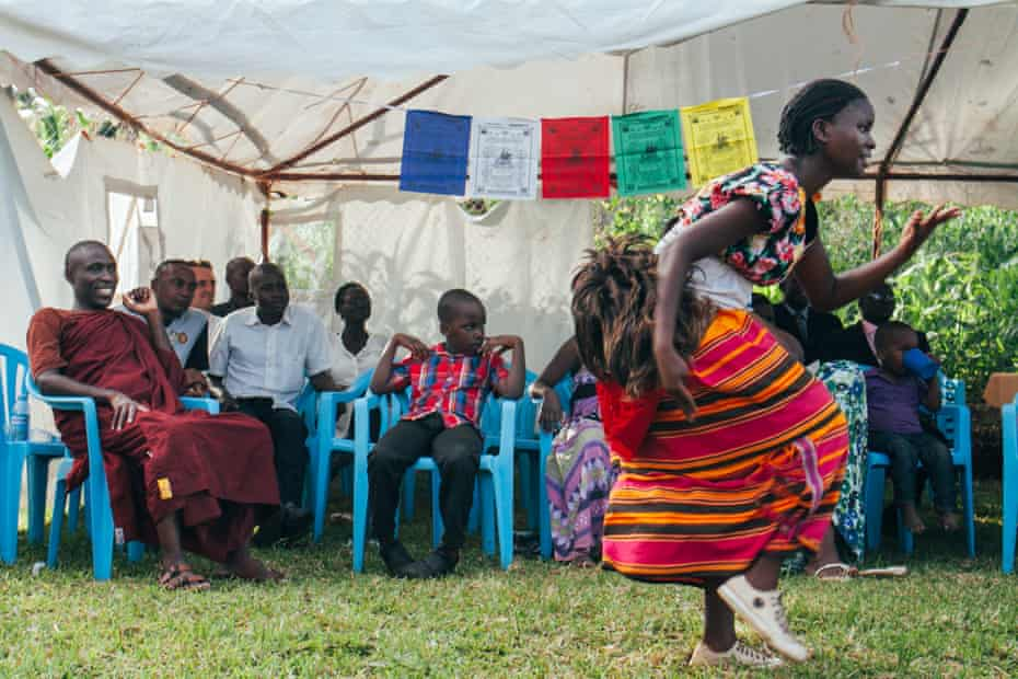 A dancer from the Acholi people from northern Uganda performs at the centre for the Vesak day festivities.
