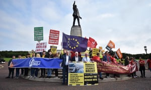 A protest taking place beneath the statue of Edward Carson at Stormont.