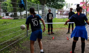 A young girl wears an Mbappé shirt while practising at the Stade Léo Lagrange in Bondy, France.