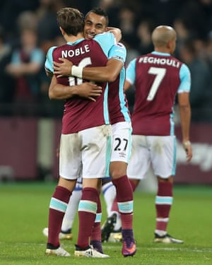 West Ham United's Dimitri Payet and Mark Noble celebrate at the end of the game.
