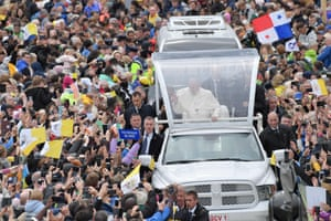 Pope Francis greets the gathered faithfull as he arrives in his popemobile to lead the Holy Mass