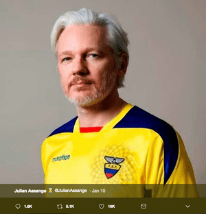 Julian Assange wearing an Ecuadorian football shirt