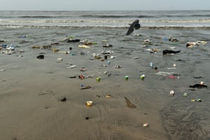 Plastic waste and trash is seen on Versova beach in Mumbai, India.