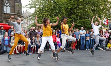 The ice-skaters Le Patin Libre entertain the crowds on the Royal Mile in 2015
