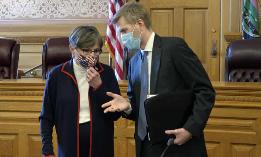 Kansas governor Laura Kelly confers with Clay Britton, her chief attorney, before a meeting about an executive order to require people to wear masks in public.