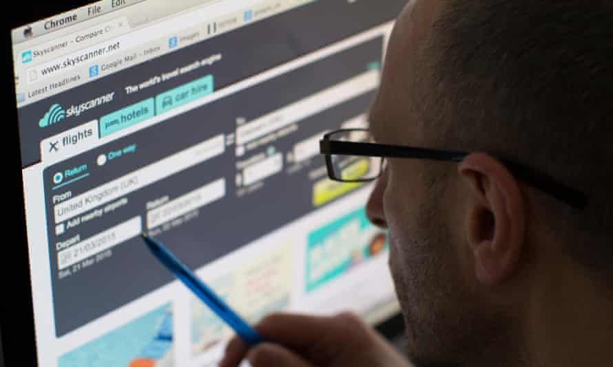 A man looks at the Skyscanner website