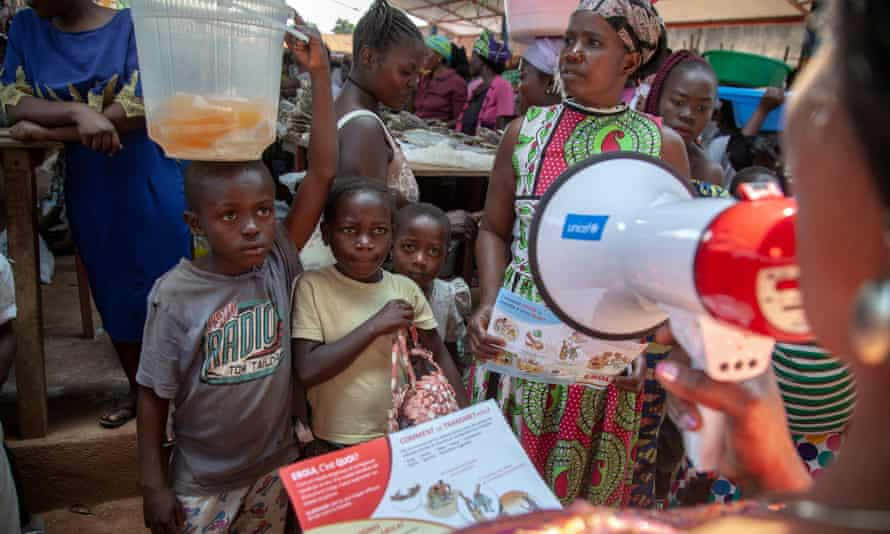 Health workers distribute leaflets in Ebola-affected Beni, Democratic Republic of the Congo on 11 August.
