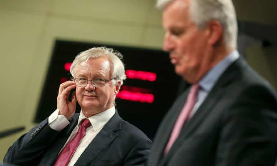 Brexit minister David Davis and EU chief negotiator Michel Barnier (right) give a press conference in Brussels.
