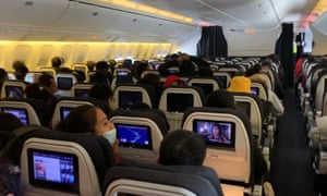 Passengers aboard an Air New Zealand flight out of Wuhan.