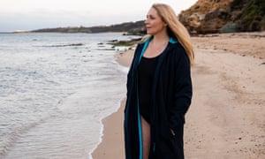 Susan Berg standing on a beach