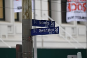 Street signs are seen during an incident on Bourke Street in Melbourne.