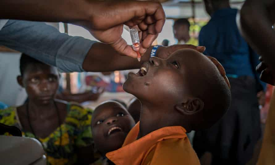 A Congolese refugee child receives a polio vaccine