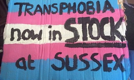 Placard reading: 'Transphobia now in stock at Sussex'