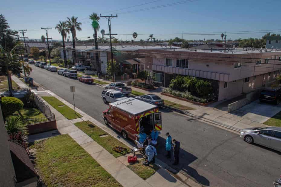 Paramedics prepare to transport a potential Covid-19 patient in Los Angeles, California.