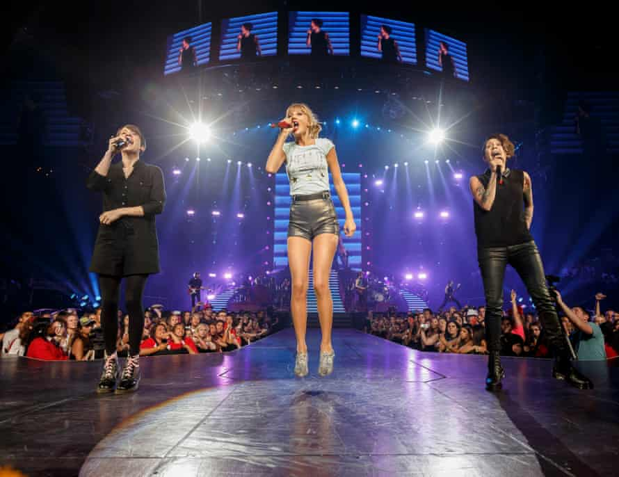 Tegan (right) and Sara on stage with Taylor Swift in Los Angeles in 2013
