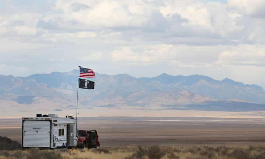 A camper with alien and American flags at a desert event in Nevada in 2019. 60 Minutes interviewed a number of credible witnesses about 'unidentified aerial phenomena'.