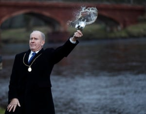 Councillor Willie Wilson blesses the river with whisky