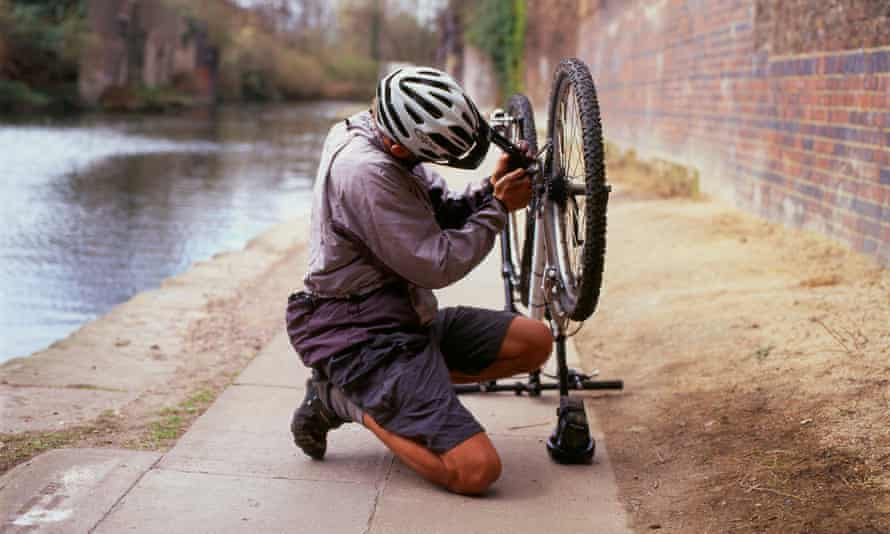 A cyclist fixing a puncture.