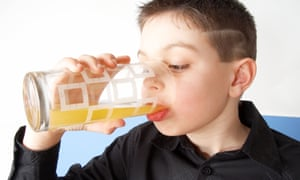 A child consumes a sugary drink