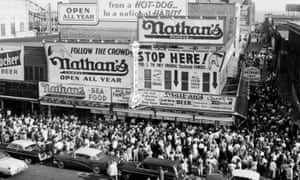 Crowds outside Nathan's Famous hotdog stand on Coney Island in 1955.