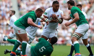 Billy Vunipola carries the ball for England during their record-breaking win at home to Ireland.