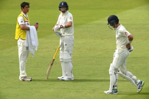England batsman Joe Denly leaves the field after being run out as Wcaptain Joe Root looks on