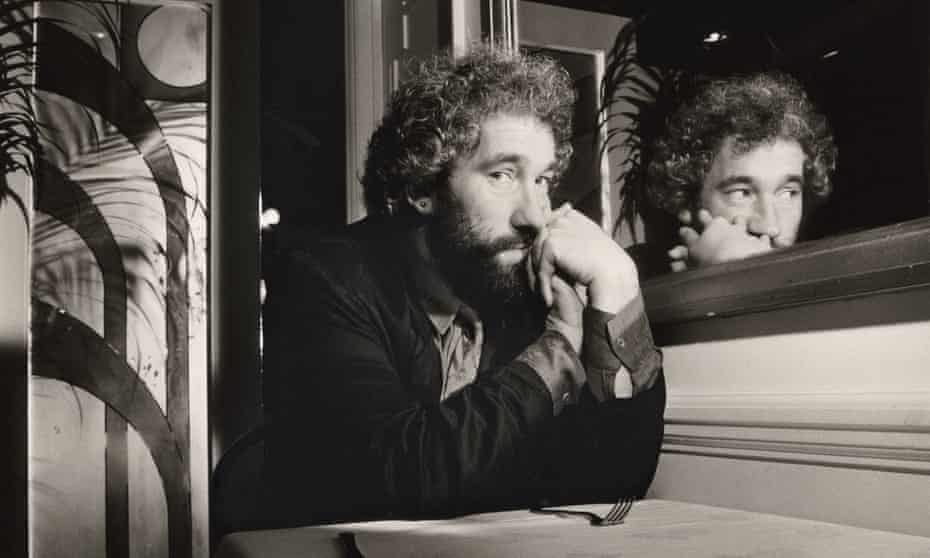 Simon Callow, photographed in 1985, sitting next to a mirror