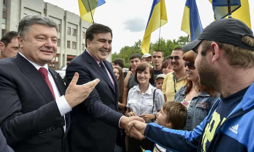 Ukraine's President Petro Poroshenko, left, and Mikhail Saakashvili meet citizens in Odessa