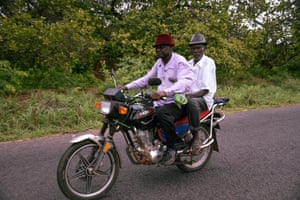 Two men ride a motorbike through rural Guinea-Bissau, near the border with Senegal.