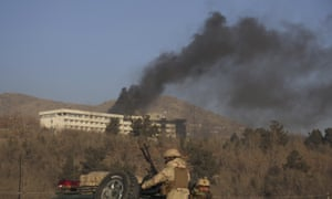 Black smoke rises from the Intercontinental hotel after an attack in Kabul.