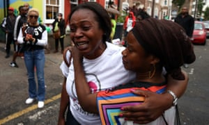 A woman is comforted outside the Kids Company in Camberwell, London after the charity's founder<br>Camila Batmanghelidjh announced its closure
