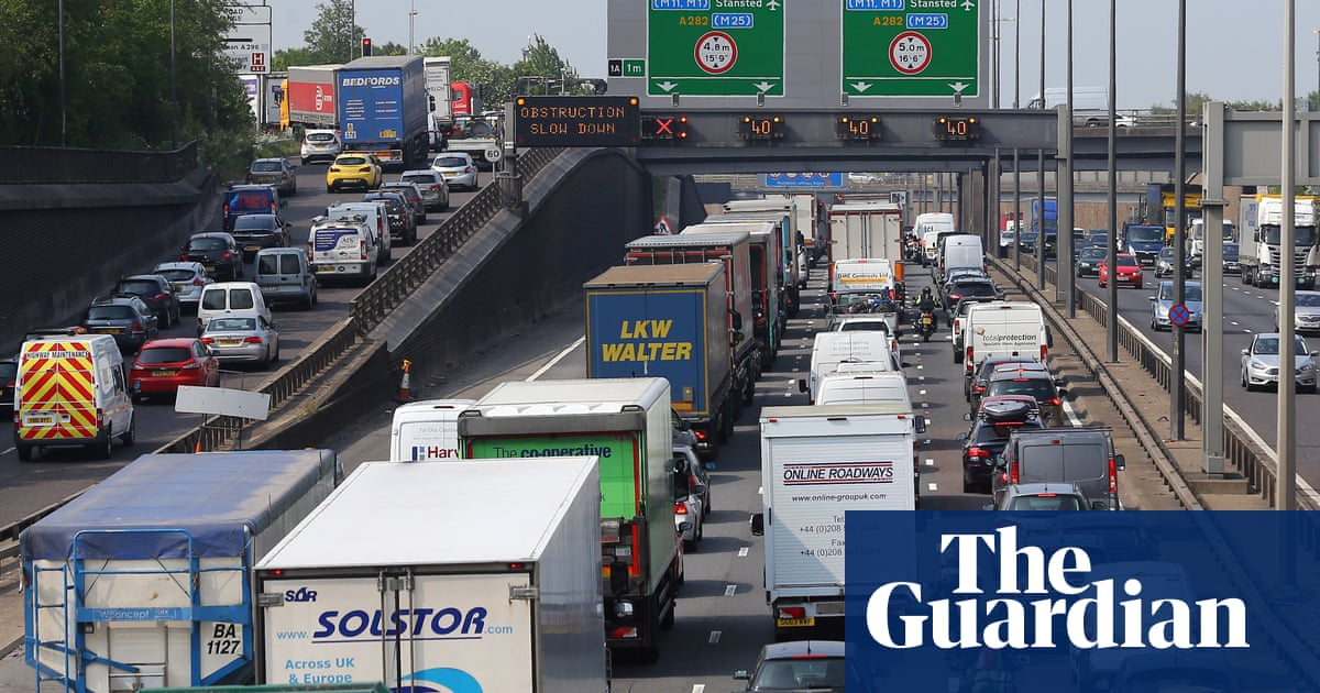 UK should cut vehicle use to hit zero-carbon target, say MPs