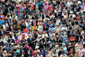 Racegoers watch the arrival of the Queen on the first day of Royal Ascot. A minute's silence was held in honour of trainer Sir Henry Cecil, 70, who died last week. He had a record 75 Royal Ascot winners.