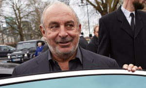 Philip Green gets into a car