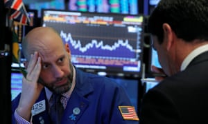 Traders works on the floor of the New York Stock Exchange today, as shares take a dive