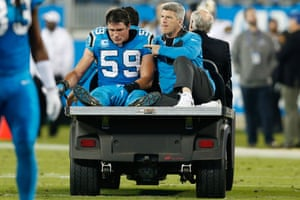 Luke Kuechly is carted from the field after an apparent concussion