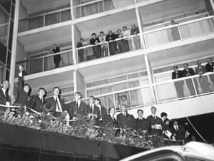 The victorious England World Cup team stand on the balcony of the Royal Garden hotel in Kensington to acknowledge the cheers of the crowds