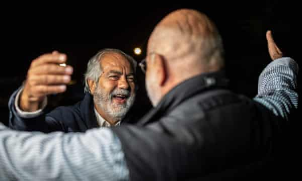 Altan greets his brother Mehmet after being released on 4 November.