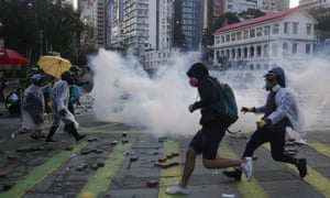 Pro-democracy protesters react as police fire teargas