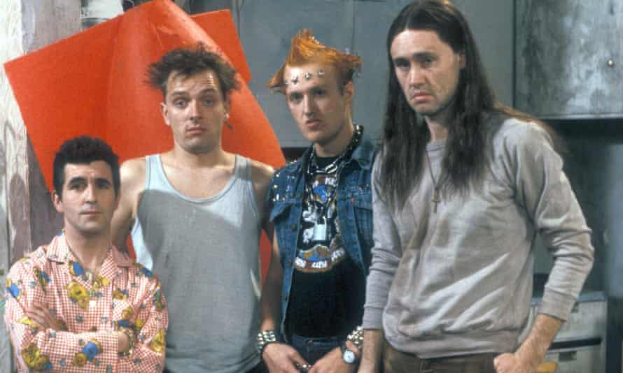 Christopher Ryan, Rik Mayall, Adrian Edmondson and Nigel Planer in The Young Ones.