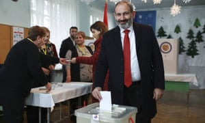 Acting Armenian Prime Minister Nikol Pashinian casts his ballot in a polling station during an early parliamentary election in Yerevan, Armenia.