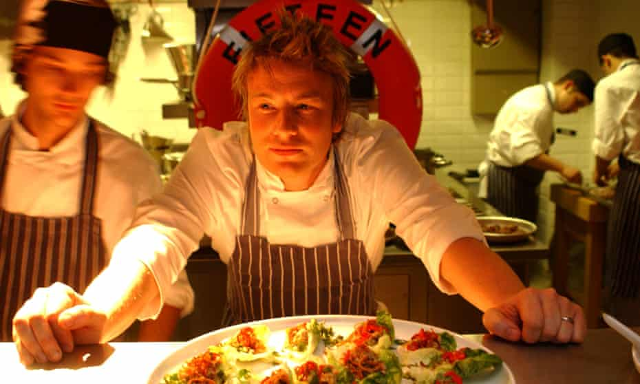 Chef Jamie Oliver in the kitchen during the launch of his restaurant Fifteen in London's Old Street